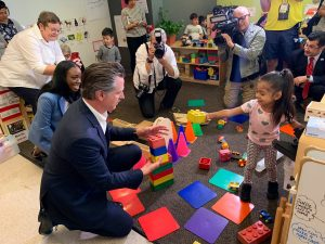 Governor Newsom and young children